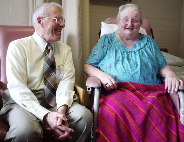 Ombudsman Robert Amyot and Joy Page,  a resident of Poet's Seat Health Care Center,  enjoy a conversation.