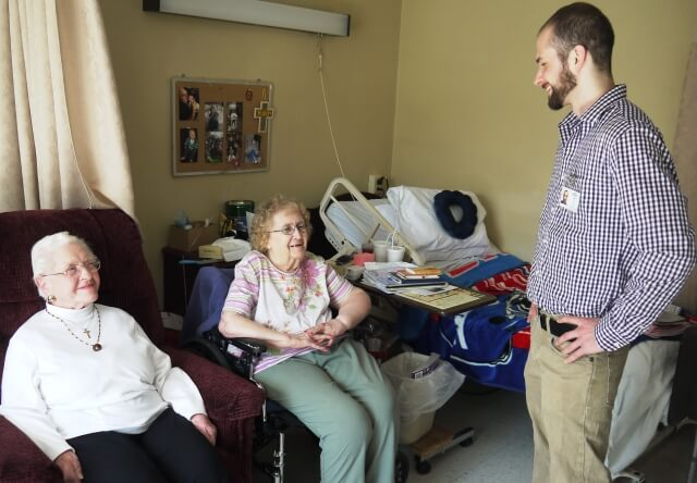 Ombudsman Ian Dore talks with Dorothy Sessions and Helen Muszynski, both residents of Buckley Healthcare Center.