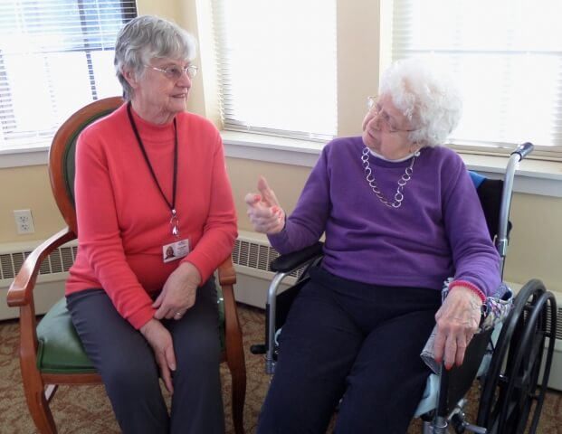 Ombudsman Annmarie Newton (left) visits weekly with Quabbin Valley Healthcare residents like Helen Douglas (right).