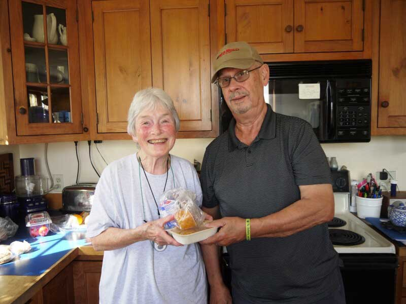 Volunteer Meals on Wheels driver Doug Riddell delivers a hot meal to Betty Moulder