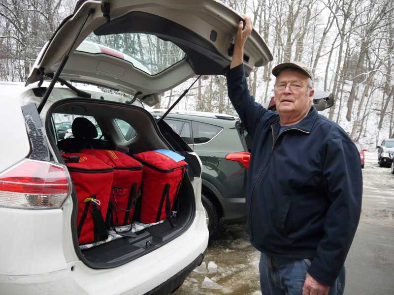 Meals on Wheels driver Bob Tidlund with food in car hatch photo for web