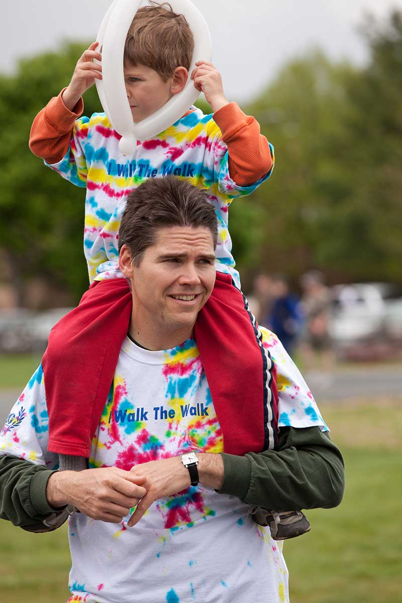 A boy with his dad at the Walkathon
