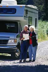 Senior man and woman with RV.