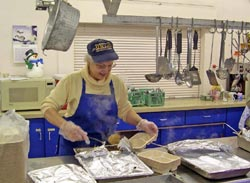 Donna Heath preparing meals at a dining center
