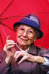 Senior woman with red umbrella.
