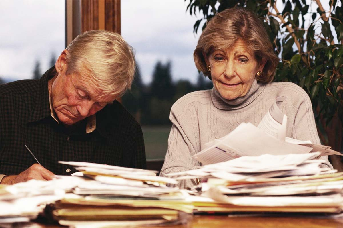 Senior man and woman with paperwork